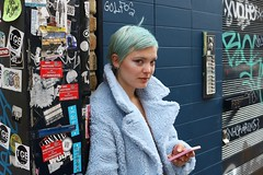 Brick Lane, London.... (markwilkins64) Tags: streetphotography street candid bricklane london uk markwilkins bluehair bluecoat mobilephone earrings