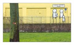 Street Art (Stik), West London, England. (Joseph O'Malley64) Tags: stik streetartist streetart urbanart freeart graffiti mural muralist westlondon london england uk britain british greatbritain art artist artistry artwork councilhousing socialhousing highdensityhousing blockofflats housingassociation privateownership housing homes dwellings abodes demolished demolition reinforcedconcretestructure steelreinforcedconcretestructure brickworkinfills brickwork brickworkcladding bricksmortar cement pointing wall fence steelfencing railings steelrailings walkway brickwall lawn grass greenery signs signage plaque fakeblueplaque tuup vents lightningconductor copperearthingstrap creeper tree barkdamage moss lichen figures stickfigures family nuclearfamily thebuiltenvironment newtopography newtopographics manmadeenvironment manmadestructure architecture documentaryphotography britishdocumentaryphotography accuracyprecision
