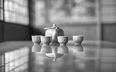 Time for tea (PeterThoeny) Tags: saratoga california siliconvalley usa sanfranciscobay sanfranciscobayarea southbay hakonegardens japanesegarden garden indoors room table teapot pot cup tea window japanesearchitecture japaneseroom japan bokeh blur dof shallowdof depthoffield shallowdepthoffield reflection monochrome blackandwhite sony a7 a7ii a7mii alpha7mii ilce7m2 fullframe vintagelens dreamlens canon50mmf095 canon 3xp raw photomatix hdr qualityhdr qualityhdrphotography fav200