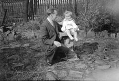 Child on a bird bath (vintage ladies) Tags: vintage blackandwhite photograph photo man male smoking cigarette child garden suit tie birdbath