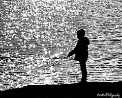 Little man playing a fishing game with a fake fishing rod (PIVAMA|photography) Tags: contrast silouette silhouette kid playing sun backlit