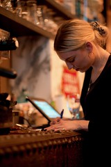 the Letter (claudia 222) Tags: noctilux waitress amsterdam human writing 50mm cafe woman