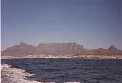 Under the mountain (BikerSpeedTriple) Tags: capetown tablemountain southafrica robbenisland seascape landscape water