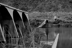Gillespie Dam BnW_5 (Ed Cheremet) Tags: abandoned architecture arizona arlingtonarizona blackwhite buildings desertargonaughtgmailcom edcheremet family genre ghosttown gillespiebridge gillespiedam miningtown nature people subject town treatment arches doors httpedcheremetartistwebsitescom