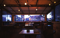Cafe Interior at Evening (dejankrsmanovic) Tags: cafe interior restaurant details object ashtray furniture table chair armchair empty nobody evening day building indoor inside seat concept hospitality refreshment entertaining enjoyment town city lifestyle street outdoor brown book menu light illumination window transparent frame conceptual architecture architectural view perspective