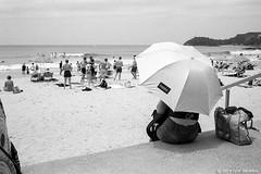 happy, Manly beach, Sydney summer 2019  #109 (lynnb's snaps) Tags: 35mm ilfordhp5 leicacl mrokkor40mmf2 manly xtol bw film street 2019 sydney australia summer coast people rangefinderphotography leicafilmphotography kodakxtoldeveloper umbrella happy surf swimmers beach