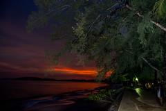 The Play of Light at the Aonang Beach (Anoop Negi) Tags: thailand aonang beach sunset fiery red tree merging lights shadows anoop negi ezee123
