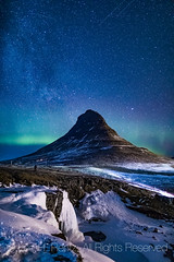 Northern Lights over Kirkjufell in Iceland (Lee Rentz) Tags: churchmountain europe gameofthrones grundarfjörður grundarfjörðurharbour iceland icelandic kirkjufell kirkjufellmountain kirkjufellsfoss mtkirkjufell snæfellsnes snæfellsnesnationalpark snæfellsnespeninsula atlanticocean aurora auroraborealis color colors dark darkness destination dramatic frozen geologic geology high landmark landscape march milkyway mountain nature night nighttime northernlights nunatak peak scenery sky starry stars tourism travel vertical volcanic waterfall wild winter