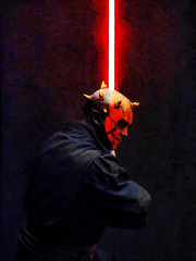 The Red Light Sabre District (Steve Taylor (Photography)) Tags: portrait black yellow white red brown dark lowkey newzealand nz southisland canterbury christchurch glow addington armageddonexpo armaggedon costume darthmaul horns lightsword lightsaber mask outfit starwars