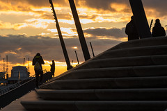 where the sky is on fire / quiet moment in a roaring world (Özgür Gürgey) Tags: 105mm baumwall d750 hafen hamburg nikon sigma people silhouettes sky steps sunset