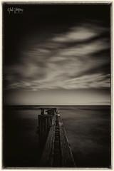 Mentone Beach (nickvertsonis) Tags: mentonebeach melbourne victoria australia historic jetty pier groyne old relic nikond810 nikon160350mmf40 monochrome blackwhite moody