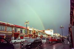 Rainbow (hiphopmilk) Tags: copyright©jaredyehwooehmoehfilms konica offroad 現場監督 zoom 35mm 135film film analog analogue jaredyeh hiphopmilk kodak travel china sichuan aba hongyuan qiongxi qiongxizhen tibetan vehicle motorbike motorcycle road street town cars rainbow sky rain shops stores