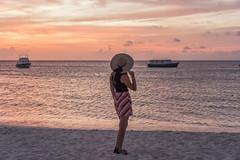 Sunset girl (mystero233) Tags: sunset sundusk clouds sky orange pink yellow sea water caribbean boat beach sand girl woman aruba island onehappyisland outdoor landscape nature