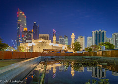 Reflecting on the Family Park Mosque, Abu Dhabi (Jhopne) Tags: mosque familypark abudhabi uae bluehour landmarktower citylights reflection canonef2470mmf28lusm sky feb19 cityscape canoneos5dmarkii city buildings