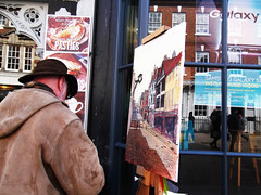 Don Levine, painting the High street (catrionatv) Tags: winchester highstreet pasties adverts windowframe glass shopwindows scarf hat hood coat reflections galaxy stool clock westgate painting canvas easel cup art artist