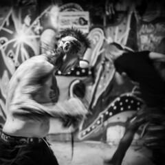 War Dance (Mikael Neiberg) Tags: impulssi impulssiband mohawk punk punkrock squat squatedhouse hardcore wardance dance move blur movement tattoos tattoo nikond700 nikoncamera carlzeiss zeisslens zeissdistagon35mmf2zf2 diy underground subculture undergroundculture