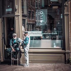 Coffeeshop Amsterdam (erikvdlinden) Tags: autumn sitting twopeople pedestrianstreet colorimage coffeeshop sunglasses stillcamera afternoon streetphotography photogear digitalcamera headset adult eyewear fall colourimage amsterdam noordholland nederland nl