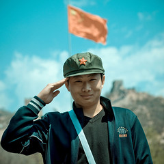 Young Man Saluting In Front Of The Great Wall, Beijing, China (Eric Lafforgue) Tags: mg9677 adultonly adultsonly ancient ancientcivilization army asia badaling beijing boy cap china chinese chineseethnicity chineseflag famousplace fortifiedwall frontview greatwall greatwallofchina hand human internationallandmark long lookingatcamera man menonly mountainrange nonurbanscene oneperson outdoor pekin portrait redarmy redstar saluting smile square standing stonewall tourism travel unescoworldheritagesite youngadult