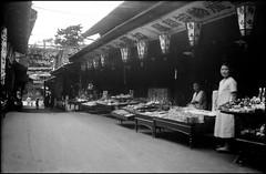 Shopping Street in Miyajima (Wolfgang Wiggers) Tags: vintage japan shoppingstreet miyajima street 1930s 宮島 日本