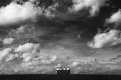 Under the Sky (HWHawerkamp) Tags: landscape cloud bw sky bench sitting resting people watching earth skies cloudy germany absoluteblackandwhite