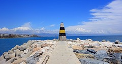 lighthouse (majka44) Tags: spanielsko spain lighthouse yellow blue atmosphere holiday stone architecture light view landscape cloud seascape