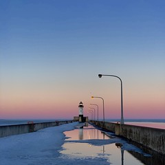 Winter Gives Way (rbodgers) Tags: puddle melt thaw frozen gradient lighthouse sunset canal canalpark duluth lakesuperior lake reflection water ice spring winter shotoniphone