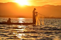 fisherman at inle lake (Neal J.Wilson) Tags: myanmar burma asia sunrise dawn sunset fisherman fishing fishingnets inle lake water travel travelling nikon traditional