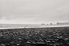 Dyrhólaey from Reynisfjara beach (Jano_Calvo) Tags: beach reynisfjara dyrhólaey kirkjubæjarklaustur iceland water rock rocky sand blackandwhite ocean sea athlantic sony a6000 ilce 1650mm alpha mirrorless cloudy nature landscape