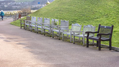 In memoriam (rhianwhit) Tags: benches bench seats seat sea front empty gone memoriam grass walk rememberance