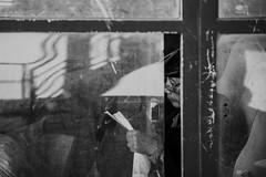 Writing (undermyne) Tags: nikon d700 black white blackandwhite bnw photo photography street life read old through glass onthebus writing note