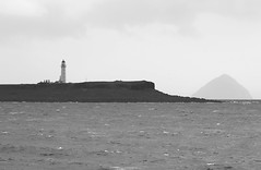 Pladda and Ailsa Craig in the gloom. (Dave Russell (1.3 million views thanks)) Tags: light house lighthouse isle island arran pladda ailsa craig firth clyde west western scotland water sea ocean marine maritime bw black white mono monochrome canon eos eos7d outdoor weather sky rock storm winter 2019