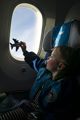 Ash Day 837 (evaxebra) Tags: poland polska 2019 trip vacation plane airplane seat sitting flight flying toy playing play lot pacifier