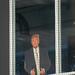 Cardboard Donald Trump watching game