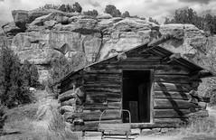 Bunkhouse (arbyreed) Tags: arbyreed old abandoned forgotten disused buildingvintage colorado chewranch logbunkhouse vintagelogbunkhouse cliff sandstone ranch oldranchbuilding monochrome bw blackandwhite