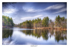 Holt Pond in April, 2019, New Hampshire, USA (Pearce Levrais Photography) Tags: landscape sony 7rm3 outside outdoor nature sky cloud water pond lake reflection tree forest branches