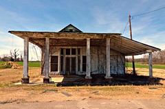 Old Store Near Covington, Tennessee (forestforthetress) Tags: color outdoor building rural country tennessee omot nikon decay ruraldecay unlimitedphotos shadows vines sky windows abandoned