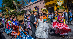 2018 - Mexico - Oaxaca - Wedding Party Parade - 1 of 3 (Ted's photos - Returns late Feb) Tags: 2018 cropped mexico nikon nikond750 nikonfx oaxaca tedmcgrath tedsphotos tedsphotosmexico vignetting dancers colorful colourful baskets flowerbaskets whickerbaskets whicker dresses entertainers bride weddingparty dancing streetscene street people peopleandpaths pathsandpeople weddingdress gown whitedress