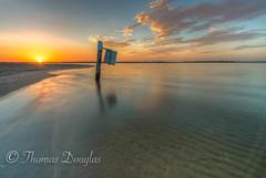Sunrise from Sans Souci Sydney (600tom) Tags: wideangle nikon beach awesome sunflair sun sandy sand ripples sign pole ocean water golden clouds australia sydney sunrise