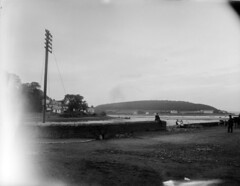 High pole, low tide and stone walls (National Library of Ireland on The Commons) Tags: ferguso'connor ferguso'connorcollection glassnegative nationallibraryofireland tidalarea houses children telegraphpole stonewall locationidentified crosshaven countycork curraghbinny riverowenabue corkharbour promontory wall terrace motorcycle sidecar wickersidecar cork explore