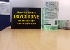 Oxycodone (Coastal Elite) Tags: oxycodone oxycontin opioid opioids medication drug painkiller painkillers disclaimer message warning sign pharmacy counter drugstore halifax novascotia canada opioïde opioïdes drugs narcotics pharmacie analgésique