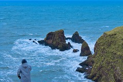 Dunnottar Castle (Simone If) Tags: sea hill cliff scotland mountain seashore seascape landscape nature hiking aberdeen dunnottar castle uk united kingdom green blue waves person back travel photograpgy film explore cinematography canon 1100d eos colors