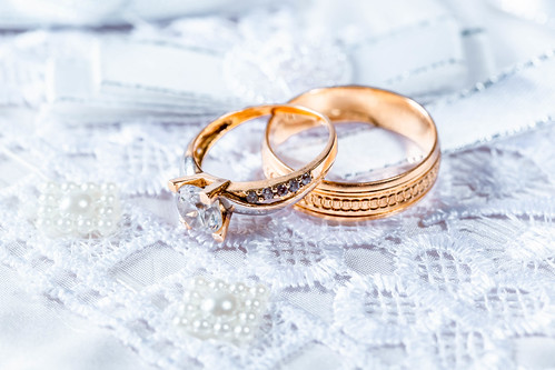 Wedding rings on a lace stand close-up