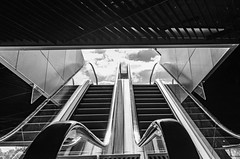 in the cloud (Rudy Pilarski) Tags: nikon nb bw bâtiment building europe europa escalator upstairs urbain urban urbano d7100 dowtown paris perspective france francia contraste cloud nuage abstract abstrait noir et blanc architecture architectura géometrie géométrique geometria géométry line ligne