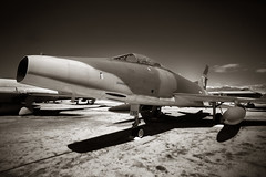 F-100 (CameraOne) Tags: f100 supersabre mach1 supersonic fast military warbird fighter bomber camouflage sepia raaw raw cameraone airfield canon6d canonef1740mm f4 bokeh riverside california marchfield jet