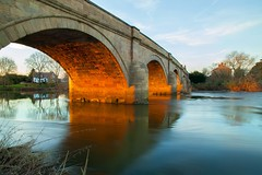 Arches of Fire (Julian Barker) Tags: swarkestone bridge derby south derbyshire east midlands england uk river trent flow golden light arch arches flowing reflections waterway julian barker canon dslr 5d mkii