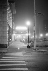 untitled-17 (dvlmnkillatron) Tags: 35mm film kodak bw selfdeveloped analog night evening champaign kodaktmaxp3200 pushed 6400 fog crosswalk thevirginiatheatre randolph
