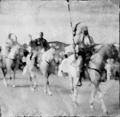 Comanches horseback. Black and white. (Richard Denney) Tags: nativeamericans comanche blackandwhite festival people horses costumes textures intentionalcameramovement