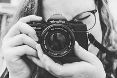 Rotterdamographee (frank_w_aus_l) Tags: rotterdam anna woman minolta xgse monochrome matte nikkor nikon bw noiretblanc netb glasses hair city hands photographer provinzsüdholland niederlande nl analog camera film sw black white rokkor lens 5014 reflection portrait cityscape fifty fotografin vintage brille