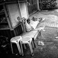 sleeping man (Stitch) Tags: weekly vendor man sleeping makeshift streetphotography store bench stool quezoncity manila philippines