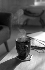 (E.Hunt.) Tags: brew coffee tea mug steaming steam plume black white film delta 400 ilford still life contrast shadow table surface lounge rest break cup soft light motion water evaporate fe2 nikon